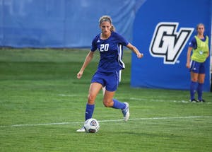 GVL / Emily FryeGabriella Mencotti takes a ball down the field during the game against SVSU on Friday September 22, 2017.
