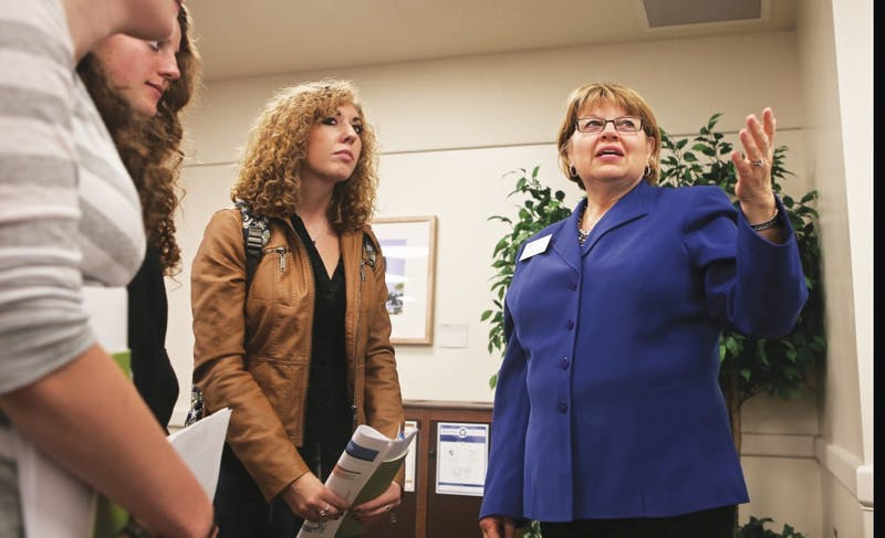 GVL/Kevin Sielaff - Lori Houghton (right) speaks with students Tuesday, Oct. 7, 2014 during the research fair held in the Grand River Room.