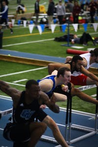 GVL / Sheila BabbittRunners make it over the first hurdle at the Bob Eubanks Openindoor track meet on January 12th, 2017.