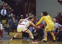 Senior forward Amanda Cahill goes for a steal against Maryland last season in Simon Skjodt Assembly Hall. Cahill and senior guard Tyra Buss will provide experience for the IU women's basketball team this season.