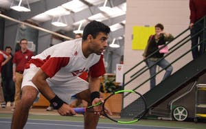 Then-junior, now-senior, Raheel Manji waits for a Louisville serve during a match Wednesday, Feb. 8, 2017, in the IU Tennis Center. IU went 1-1 this weekend to conclude its regular season.