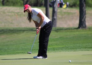 Then-sophomore, now-junior Erin Harper putts during the first round of the IU Invitational on April 8, 2017, at the IU Golf Course. Harper and the Hoosiers finished ninth at the Big Ten Championships.