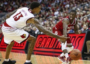 Senior guard Josh Newkirk passes the ball during the Hoosiers' game against the Louisville Cardinals on Saturday at the KFC Yum! Center in Louisville, Kentucky. The Hoosiers fell to the Cardinals, 71-62.