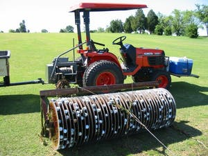 Rawhide Golf Ball Co. collects golf balls lost at the bottom of ponds and resells them. Rollers are connected to tractors to collect submerged balls.