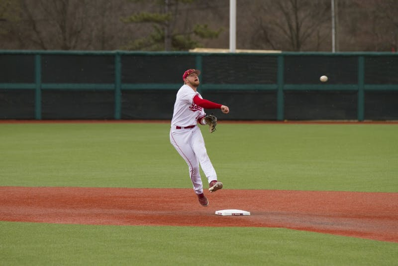 Second baseman Matt Lloyd throws the ball to first base to make the out against Cincinnati on Tuesday, March 6, at Bart Kaufman Field. IU recently defeated Northern Illinois on Friday, 18-0, to improve to 13-4 on the season.
