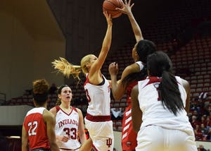 Senior Guard Tyra Buss takes a shot against Western Kentucky but falls short at the game on Friday in Simon Skjodt Assembly Hall. IU defeated Western Kentucky, 73-71.