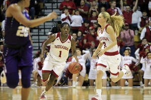 Freshman guard Bendu Yeaney runs alongside senior Tyra Buss. The Hoosiers defeated the TCU Horned Frogs, 71-58, Thursday at Simon Skjodt Assembly Hall during the WNIT semifinals.