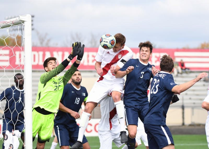 Senior defender Grant Lillard heads a ball off of a corner kick against Penn State on Monday afternoon at Bill Armstrong Stadium. Lillard had five shots in IU's 1-0 overtime win against Penn State in the first round of the Big Ten Tournament.