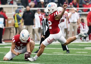 Senior kicker Griffin Oakes kicks an extra point during the first half against Wisconsin on Nov. 4 at Memorial Stadium. Oakes is IU's all-time leader in field goals made.