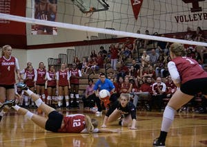 Junior defensive specialist Samantha Fogg and sophomore defensive specialist Meaghan Koors dive to keep the ball alive against Maryland on Sept. 23 at the University Gym. IU is now 1-17 in conference play entering the final two matches of the regular season.