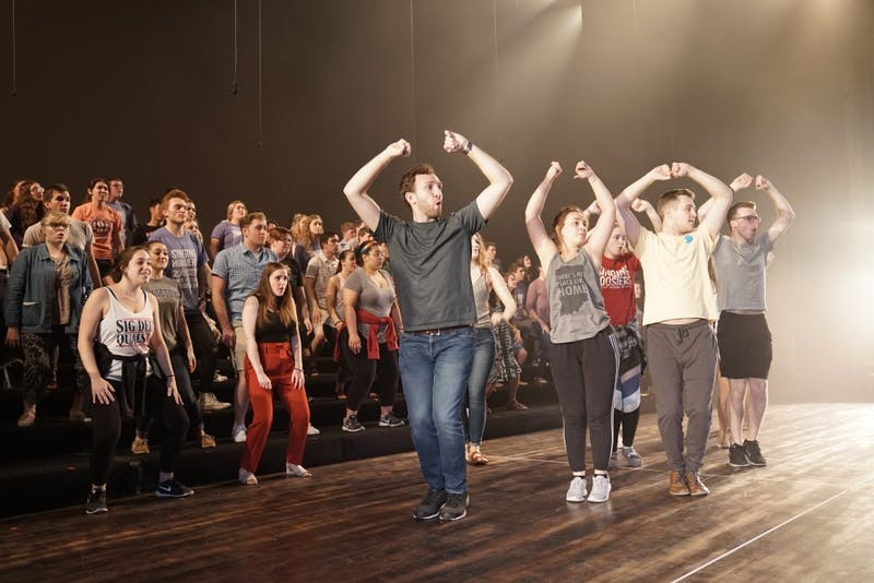 """Members of the Singing Hoosiers rehearse the routine of Michael Jackson's """"Thriller"""" for their 68th annual Spring Concert this Saturday at the IU Auditorium. Founded in 1950, the Singing Hoosiers carry on over half a century of tradition as IU's ambassadors of song."""