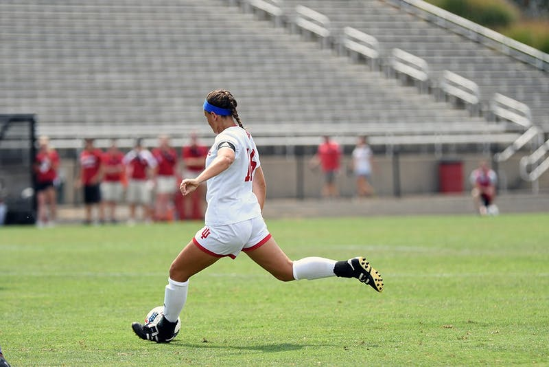 Senior midfielder Kylie Kirk kicks the ball against Clemson on Aug. 20 at Bill Armstrong Stadium. IU released its 2018 schedule Tuesday.