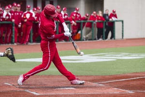 Senior outfielder Logan Sowers hits an RBI single into center field against Northwestern on April 15 at Bart Kaufman Field. Sowers had two RBI for IU against Maryland on Friday.