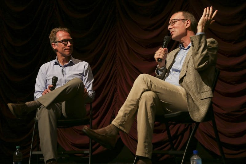 """IU Cinema Director Jon Vickers (left) talks with filmmaker Robert Weide (right) on Thursday, May 10, at IU Cinema. The two discussed Weide's documentary """"Kurt Vonnegut: Unstuck in Time"""" as part of the Granfalloon festival."""