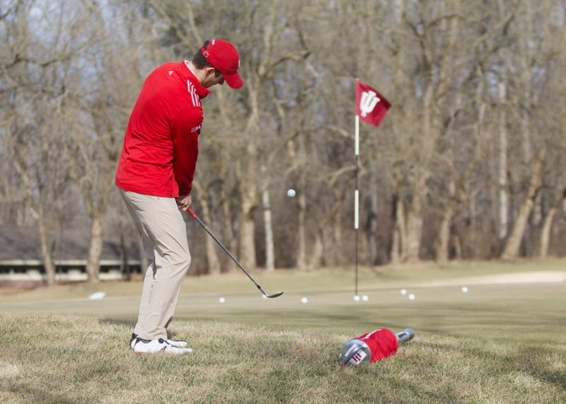 Senior Christain Fairbanks practices chipping onto the green at the IU Golf Course during practice in Jan. 2018. The IU men's golf team finished fifth at last weekend's Big Ten Match Play tournament.
