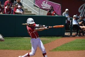 Senior infielder Rachel O'Malley swings and makes contact with the ball during IU's game against Michigan State in May. O'Malley and the Hoosiers are 4-2 in fall season play under new Coach Shonda Stanton.