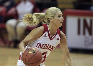 Senior guard Tyra Buss looks for an opportunity to score or pass the ball to a teammate during the game against Southern University. By halftime, IU was up 36-32. The game was Tuesday at Simon Skjodt Assembly Hall.