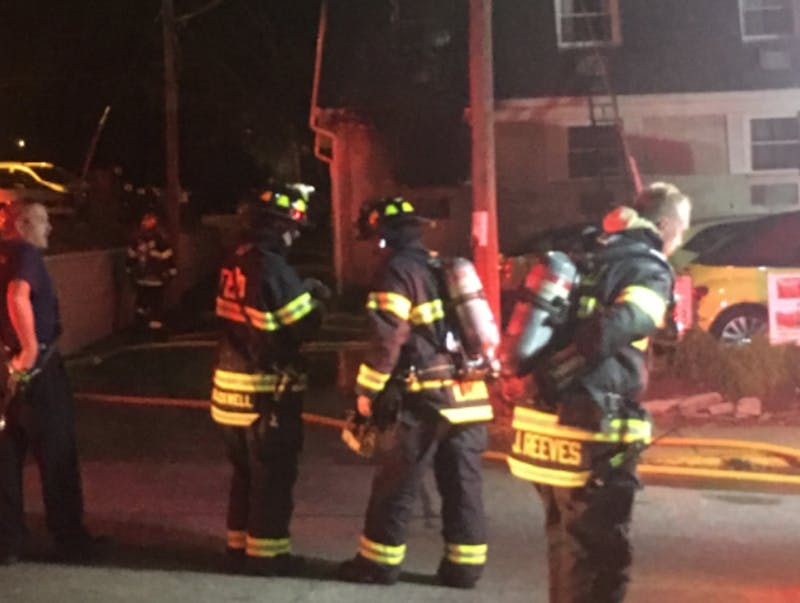 Bloomington firefighters work outside the Rara Avis apartment building at 417 S. Fess Ave. on Thursday night. Officials said one person was taken to the hospital.