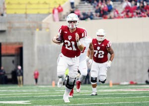 Senior quarterback Richard Lagow runs the ball against Wisconsin on Nov. 4 at Memorial Stadium. Lagow will play his final regular season game with IU this Saturday in West Lafayette, Indiana, against Purdue.