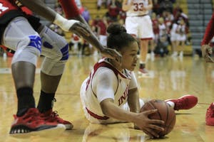 Freshman guard Jaelynn Penn dives for the ball after dropping it Jan. 27 in Simon Skjodt Assembly Hall against Rutgers. Penn scored a career-high 25 points Thursday night against UT-Martin, advancing the Hoosiers to the second round of the WNIT.