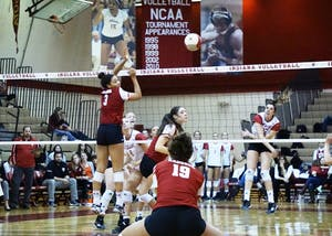 Freshman outside hitter Kamryn Malloy spikes the ball for a kill against the Wisconsin Badgers on Friday night at the University Gym. IU lost against Wisconsin and Minnesota this past weekend, dropping its overall record to 12-16.
