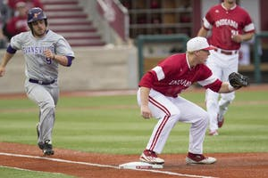 Sophomore Scotty Bradley fields an out at first base against Evansville during the second inning during the 2016 season at Bart Kaufman field. Bradley and the Hoosiers split a doubleheader with Iowa to begin Big Ten play.