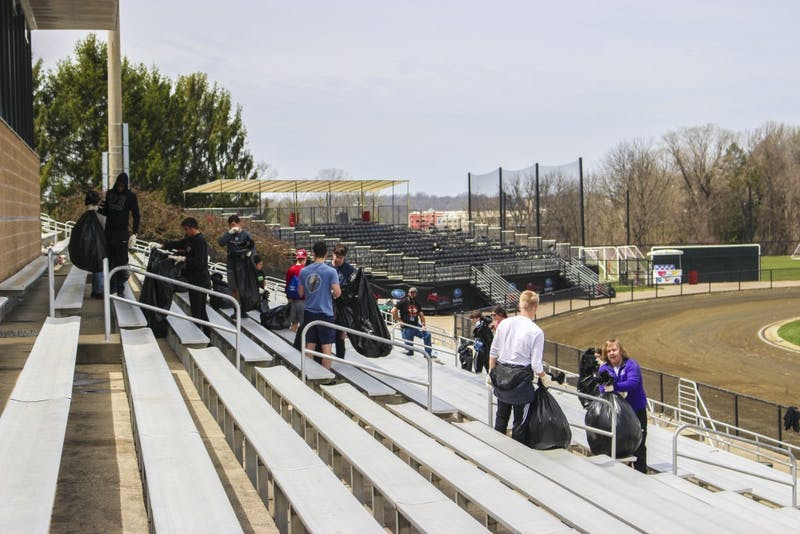 Students who received a drinking violation ticket over the Little 500 weekend clean up trash Sunday afternoon at Bill Armstrong Stadium as part of the pretrial diversion program. This year's number of drinking tickets was especially low.