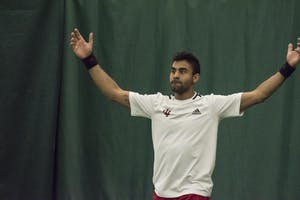Senior Raheel Manji celebrates his 3-6, 6-3, 6-2 singles win over Wisconsin on Sunday at the Indiana University Tennis Center. The Hoosiers will face Penn State and Ohio State at home this weekend.