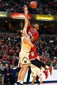 Junior forward Juwan Morgan attempts a shot against Notre Dame Saturday afternoon in Bankers Life Fieldhouse. Morgan had 34 points and 11 rebounds in IU's 80-77 win against Notre Dame.