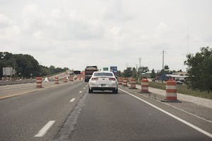 Safety cones and signs line Section Five of State Road 37 as construction continues.