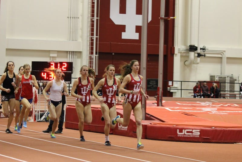 Junior Haley Harris leads freshman distance runners Hannah Stoffel and Lexa Barrott in the 1 mile fast race at the 2018 Hoosier Hills meet. The distance runners will split up with the throwers this weekend as they compete in different invitationals.