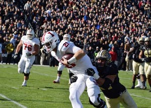 Senior quarterback Richard Lagow attempts to run the ball but falls short during the Old Oaken Bucket game on Nov. 25, 2017, in West Lafayette, Indiana. Lagow was one of five IU seniors who took part in postseason bowl games.