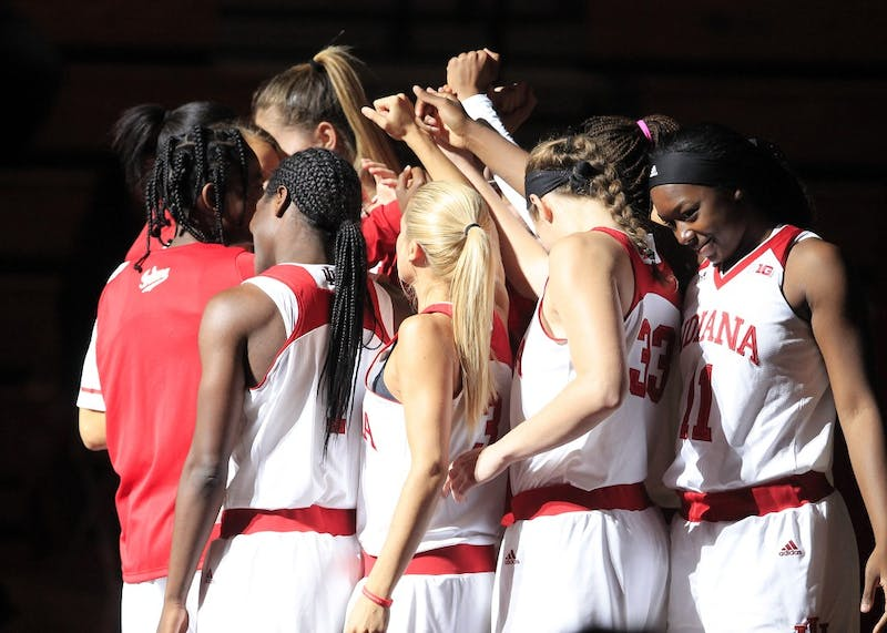 The IU women's basketball team huddles with Coach Teri Moren before facing Southern University. The Hoosiers play at Michigan State on Saturday at 4 p.m.