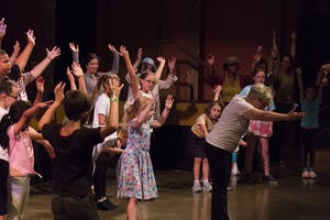Dance instructor Mary Sue Hosey leads participants in a bow after teaching them dance moves Friday, June 22, in the Buskirk-Chumley Theater. Hosey teaches at The Dance Center, which is located at 223 S. Pete Ellis Dr. #14 in Bloomington.