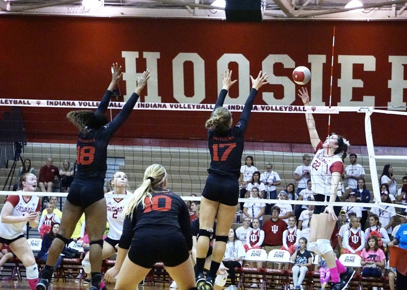 Freshman outside hitter Kamryn Malloy tips the ball over for a point against the Rutgers Scarlet Knights on Oct. 20 during a Big Ten match. IU finished the 2017 season 1-19 in conference play.