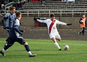 Junior midfielder Austin Panchot kicks the ball against Old Dominion in the second round of the NCAA Tournament Sunday afternoon at Bill Armstrong Stadium. Panchot scored IU's third goal of the match in the Hoosiers' 3-0 win against Old Dominion.