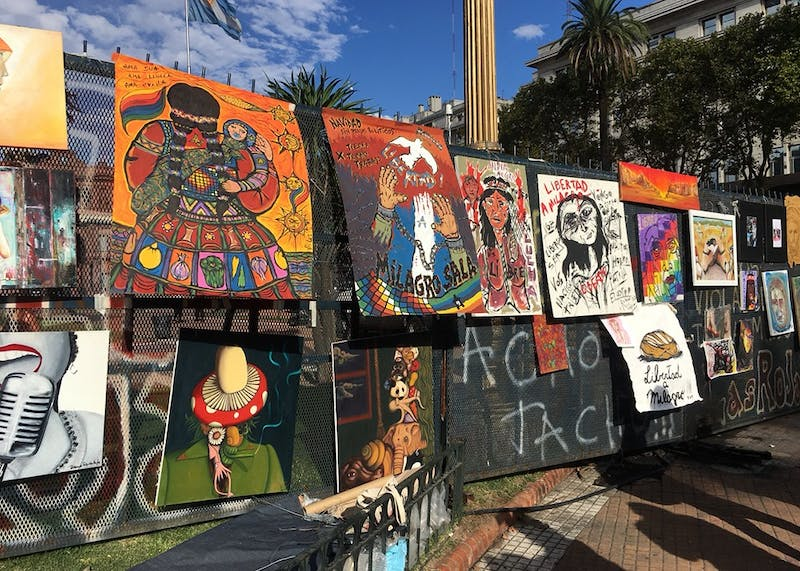 Protestors' works are attached to fences in La Plaza de Mayo during an anti-government demonstration on International Women's Day. The government under President Mauricio Macri opposes the legalization of abortion and stricter laws against femicide.