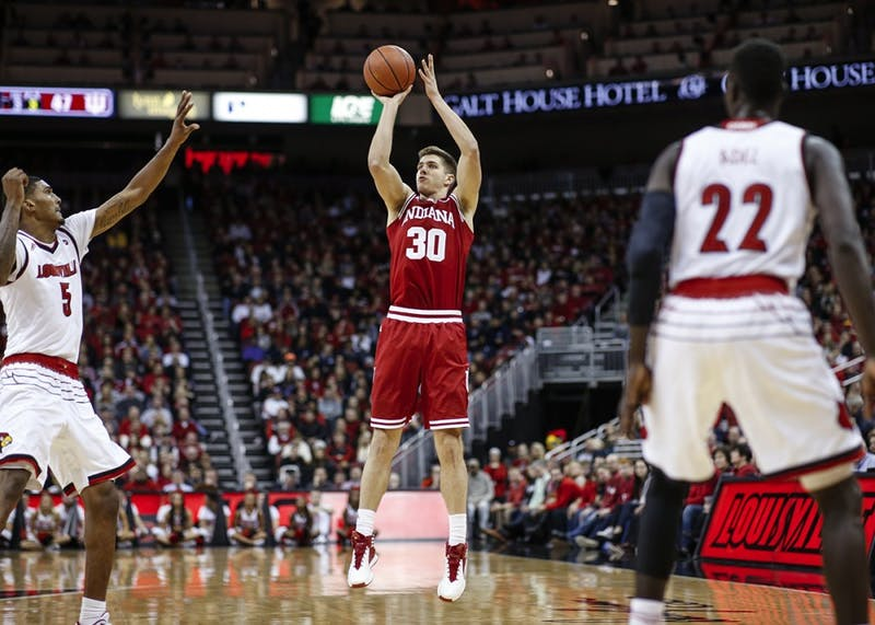 Senior forward Collin Hartman attempts a shot during the Hoosiers' game against the Louisville Cardinals on Saturday at the KFC Yum! Center in Louisville, Kentucky. The Hoosiers fell to the Cardinals, 71-62.