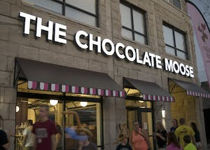 The new Chocolate Moose storefront glows bright during the grand reopening Sunday night. Although the 401 S Walnut St. location remains the same, the original stand was torn down in November for a new apartment complex to be built overhead.