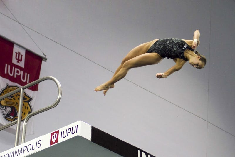 Then-sophomore diver Jessica Parratto, now a junior, dives in a 2016 women's 10-meter event at the IUPUI Natatorium. Parratto and three other Hoosiers earned Big Ten weekly honors after their performances against Michigan