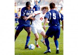 IU sophomore Jacob Peterson shields the ball from two University of California at Santa Barbara players during the 2004 NCAA College Cup Final at the StubHub Center, then known as the Home Depot Center, in Carson, California. The Hoosiers defeated UCSB in penalty kicks to win the program's seventh national title.