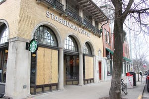 The Starbucks on Indiana Avenue has boarded up windows after rocks were thrown through the window on Sunday evening. Since surveillance cameras were not working at the time, the Bloomington Police Department has no leads.