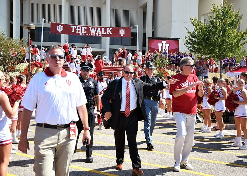 "Coach Tom Allen and Athletics Director Fred Glass walk down ""The Walk"" prior to the Indiana football game on Sept. 23. Allen introduced new linebackers coach Kane Wommack during a press conference Sunday at Simon Skjodt Assembly Hall."