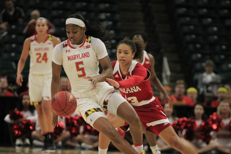 Freshman guard Jaelynn Penn goes to hit the ball out of her Maryland opponent's hand. IU fell to Maryland, 67-54, on Friday, March 2, at Bankers Life Fieldhouse in Indianapolis.