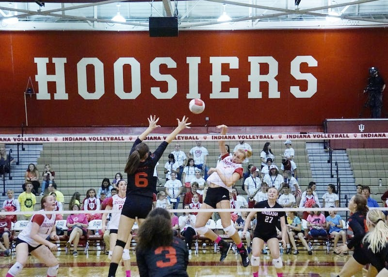 Sophomore middle blocker Hayden Huybers spikes the ball for a kill against the Rutgers Scarlet Knights on Oct. 20, 2017. IU's lone win in conference play during the 2017 season came against Rutgers, 3-2.