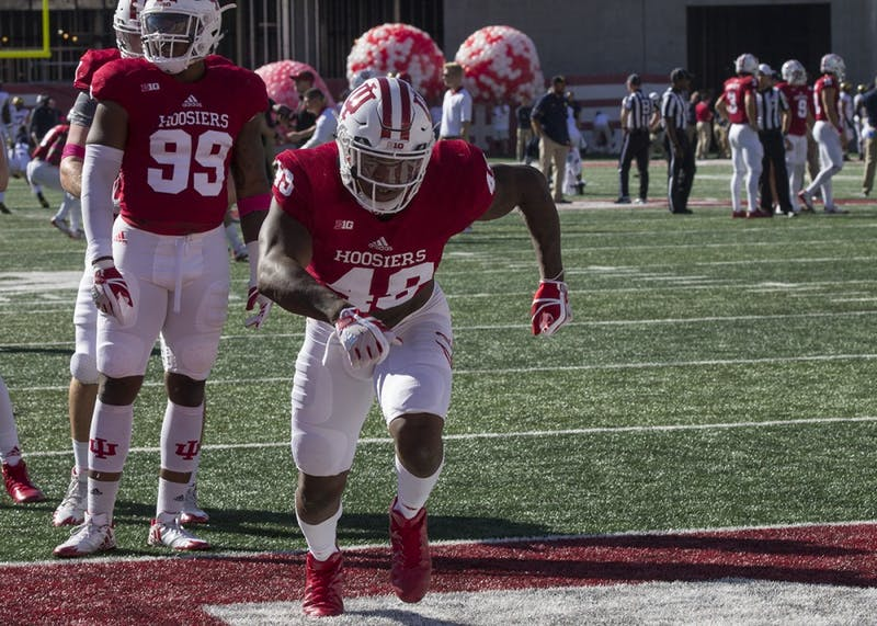 Junior inside linebacker Greg Gooch works on his blocking in warm ups before IU's game against Michigan last Saturday. IU's linebackers, led by seniors Tegray Scales and Chris Covington, will be tasked with tackling Michigan State junior running back LJ Scott this week.