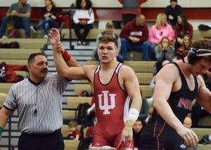 Sophomore Devin Skatzka takes down his opponent with a pin early in the match in the 174-pound category during the Hoosier Duals at the University Gym on Dec. 2. Skatzka was one of three Hoosiers to pick up a victory in Sunday's loss at No. 2 Ohio State.