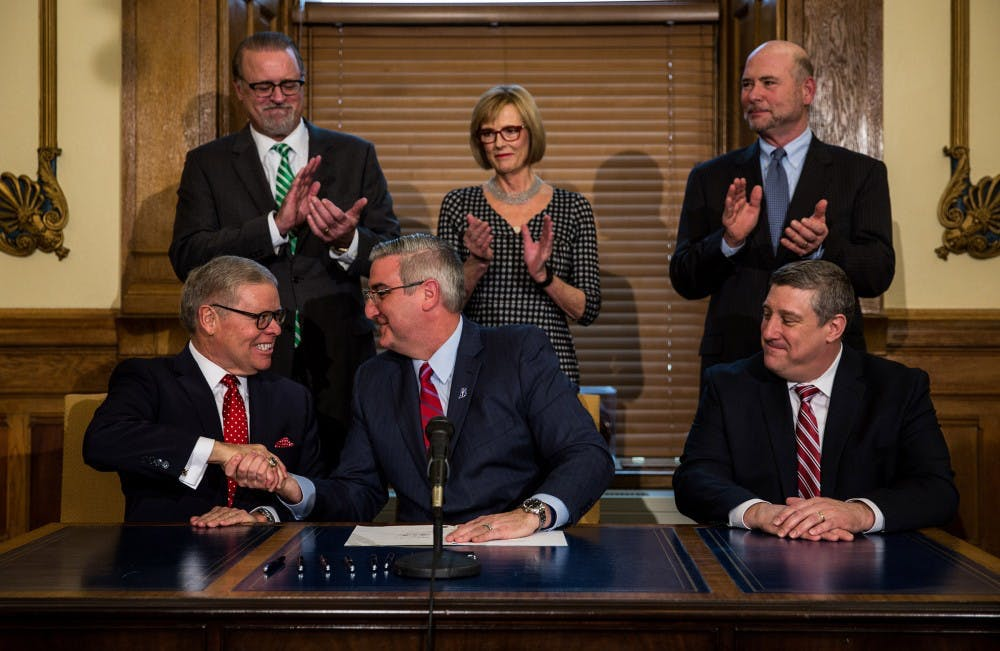 Holcomb signs Sunday sales bill