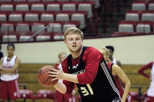 Senior Austin Halcomb passes the ball to a teammate while practicing with the women's basketball team Friday, Feb. 16. Halcomb, along with several other men, helped the women's team practice the day before senior day, when IU faced Nebraska for its last home game of the regular season.
