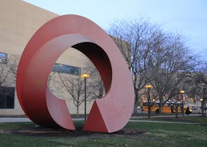 The Indiana Arc, outside the Eskenazi Art Museum of Art, was built in 1995. It is made of aluminum and was built by Charles Perry, an American sculptor known for his large public sculptures.